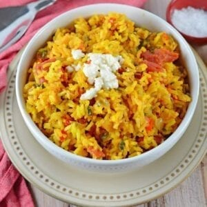 Mexican Rice is a zesty side dish recipe packed with vegetables and flavor. Serve with your favorite Mexican recipes, inside burritos or as its own dish.