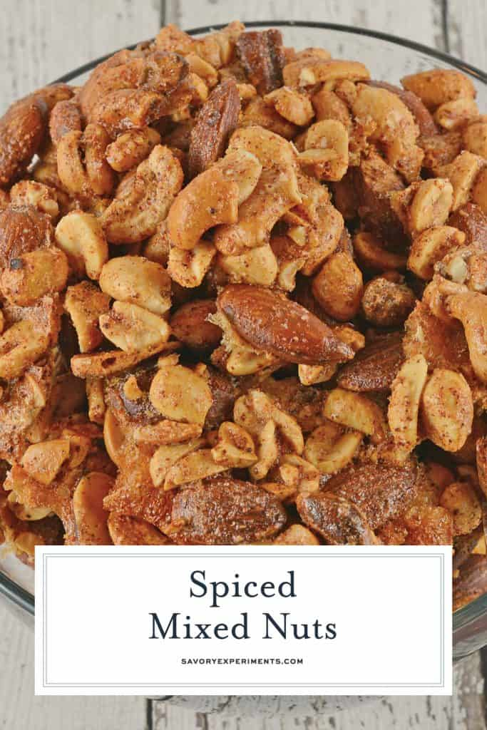 Spiced Nuts are an easy and flavorful blend perfect for snacking. Made with shelled peanuts, cashews, pistachios, and almonds, this recipe creates the perfect party munchie! #snackmix #spicednutsrecipe #mixednuts www.savoryexperiments.com