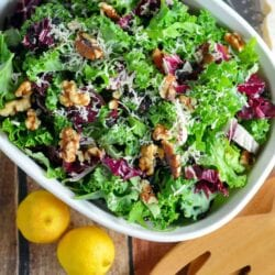 Kale Salad Recipe-tossed with currants, radicchio, walnuts and a lemon dressing. Find out my secret tips on making your kale salads silky smooth and how to make kale chips with the leftovers! www.savoryexperiments.com