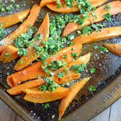Parmesan Garlic Baked Sweet Potato Fries- take this super food up a few notches with a garlicky, Parmesan topping on top of sweet potato fries with a crispy outside with a soft and sweet inside. I eat a whole batch as a meal! www.savoryexperiments.com
