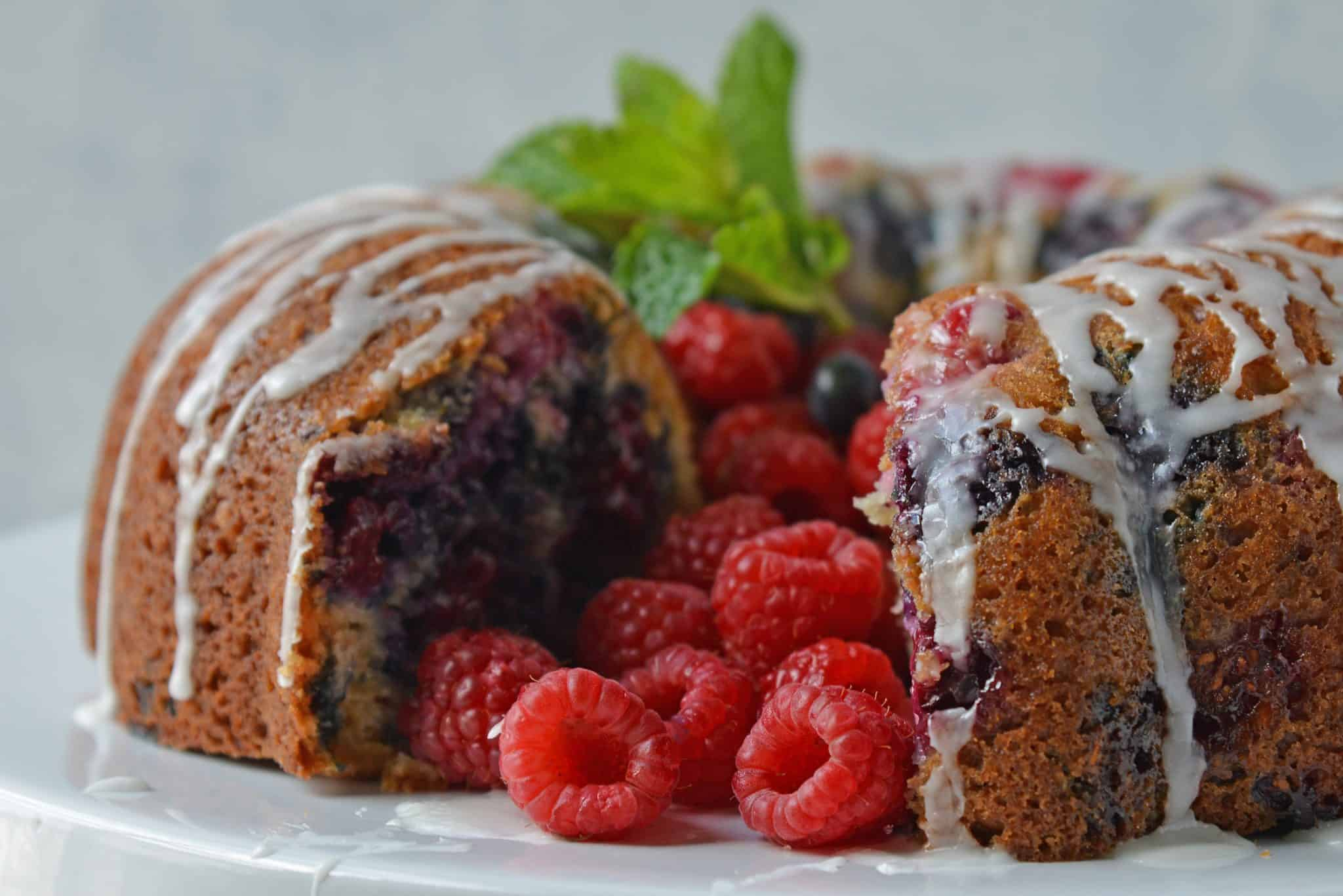 You will be making this Berry Buttermilk Pound Cake all year long! Fresh or frozen berries, this buttermilk cake is delicious and perfect for dessert or brunch. #buttermilkcake #buttermilkpoundcake www.savoryexperiments.com