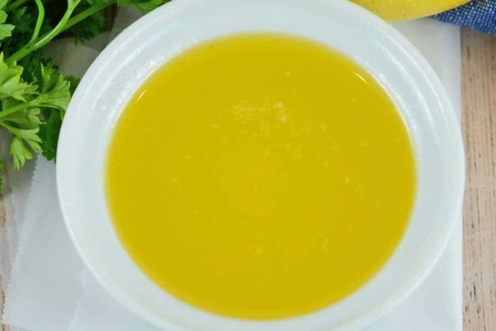 This clarified butter recipe shows you How to Make Clarified Butter in only 10 minutes or less! It's the perfect sauce to pair with seafood! #howtoclarifybutter #clarifiedbutter www.savoryexperiments.com