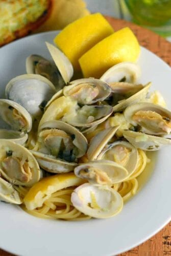 Clam Sauce Recipe- just like at the restaurant, plus see me super easy tips for cleaning clams for any recipe! Buttery broth, chopped and whole clams in an easy shallot, garlic and parsley sauce. Ready in just 40 minutes! www.savoryexperiments.com