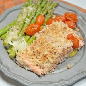 Sheet Pan Crispy Salmon is a fast, easy and healthy weeknight meal. Prep this sheet pan meal in just 5 minutes using tomatoes, asparagus and a crispy panko and walnut topping for you salmon.