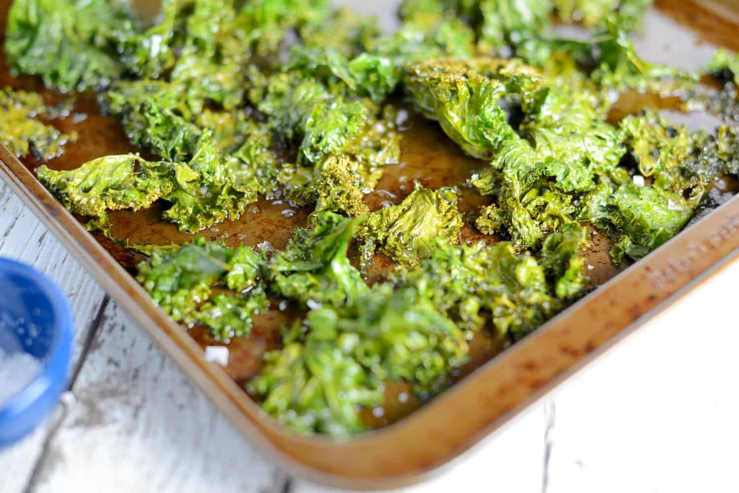 Kale Chips Recipe- olive oil, sea salt and 3 other creative add-ins! A tasty, easy, and healthy alternative to potato chips.