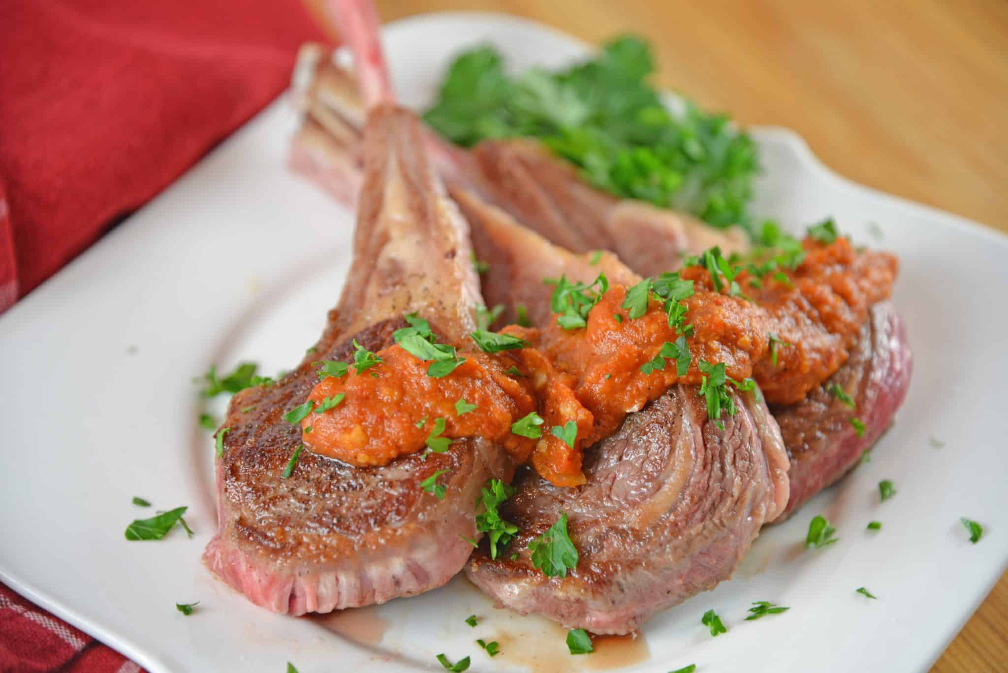 Lamb Chops, also known as Lamb Lollipops, are one of the easiest dinners to make! Only 10 minutes to cook with a smoky romesco sauce and you are ready to dine!