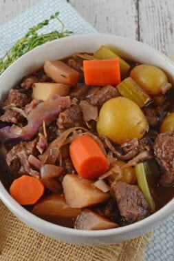Beef Stew is one of the world's best comfort foods. However Red Wine Beef Stew filled with vegetables and a savory broth. #beefstew #stovetopbeefstew www.savoryexperiments.com
