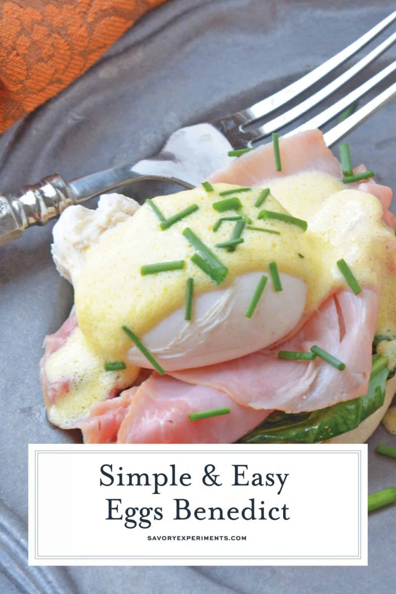 A close up of eggs benedict with chives