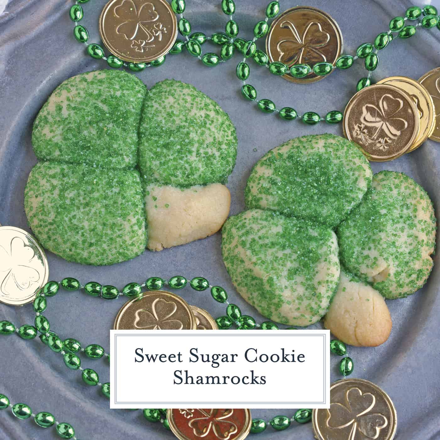 Sugar Cookie Shamrocks bring the luck of the Irish with them. St. Patrick's Day cookies creatively molded to make green lucky clovers, a great St. Patrick's Day dessert recipe. #stpatricksdayfood #stpatricksdaydessert www.savoryexperiments.com