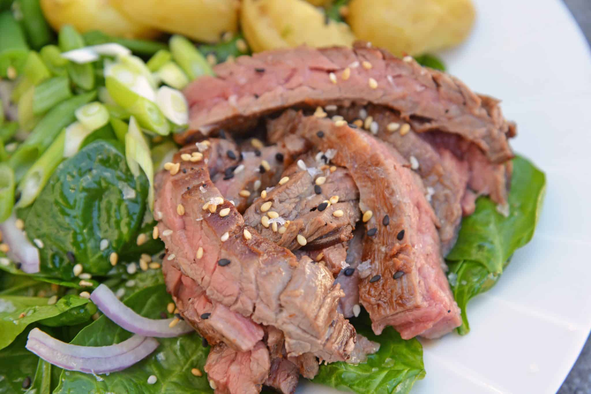 Skirt Steak Salad - an easy and healthy dinner solution that uses 6 ingredients and a simple homemade miso ginger dressing. The only steak salad recipe you need! #steaksaladrecipe #skirtsteaksalad www.savoryexperiments.com
