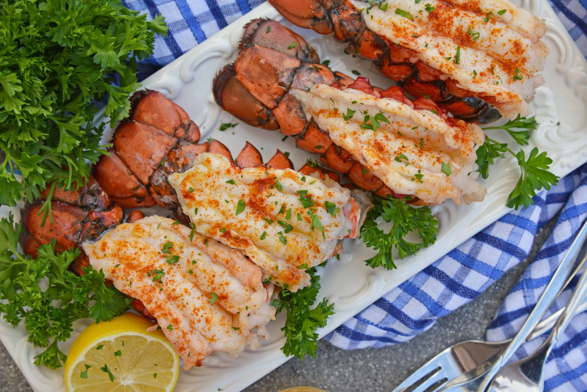 Broiled Lobster Tails with Lemon Butter brings the feel of a fancy restaurant right to the comfort of your own home and is ready in just minutes! #howtocooklobstertails #broiledlobstertails www.savoryexperiments.com