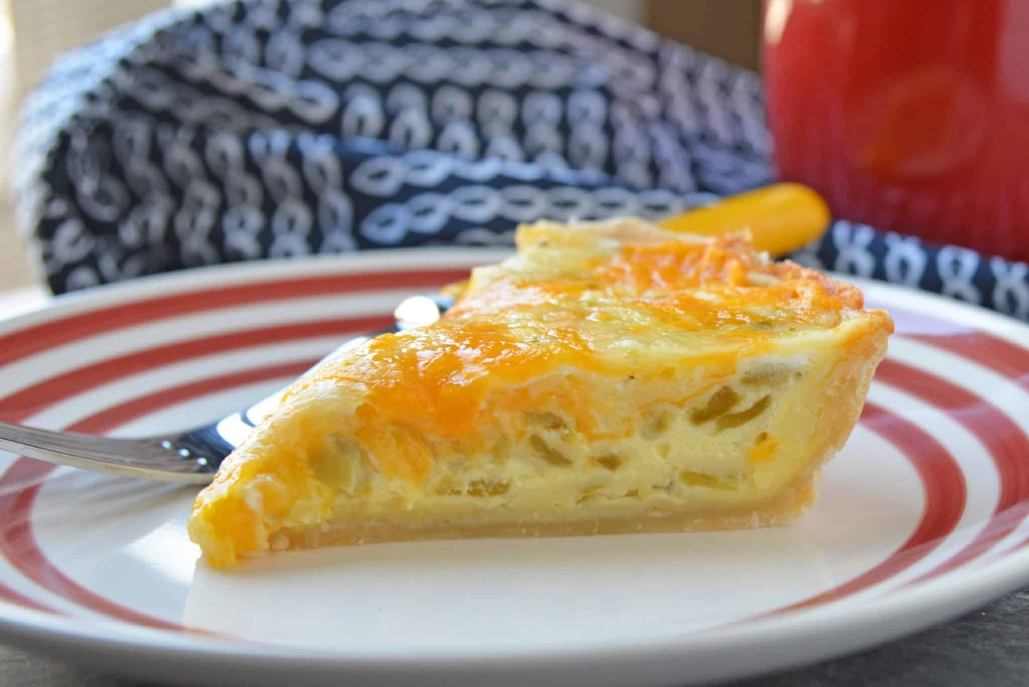 Chile Relleno Quiche is the perfect brunch recipe! It's loaded with flavor from hatch chiles, two kinds of cheese, and spices! #quicherecipe #bestquicherecipe #cheesyquiche www.savoryexperiments.com