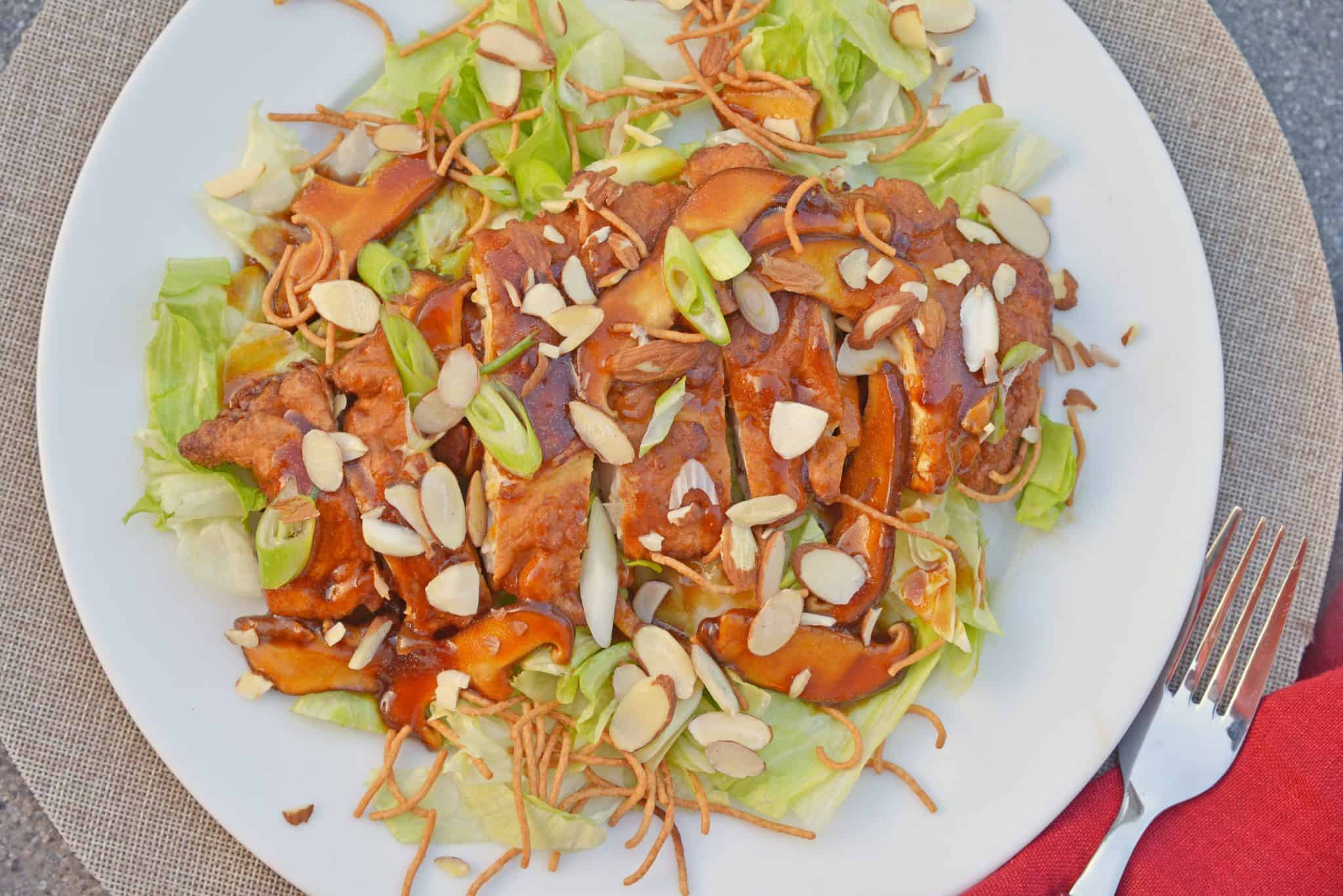 Chinese Almond Chicken, aka Detroit Almond Chicken, ABC Chicken or Almond Boneless Chicken, is a dish with fried chicken and mushroom gravy served over iceberg lettuce. #almondchicken #almondbonelesschicken www.savoryexperiments.com