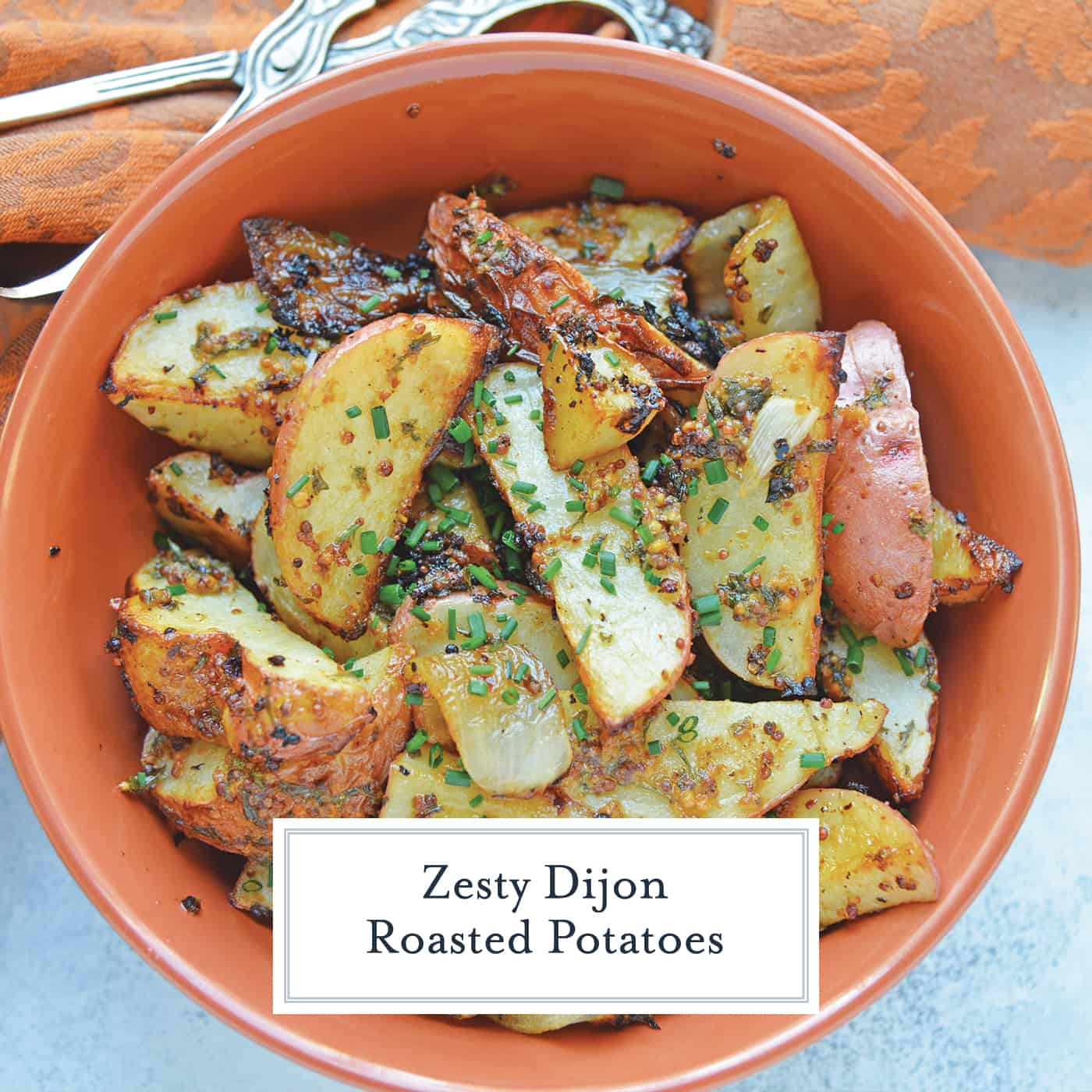This Dijon Roasted Potatoes recipe is the perfect potato side dish to serve alongside chicken or steak! These oven roasted potatoes are packed full of flavor! #ovenroastedpotatoes #roastedpotatoesrecipe www.savoryexperiments.com