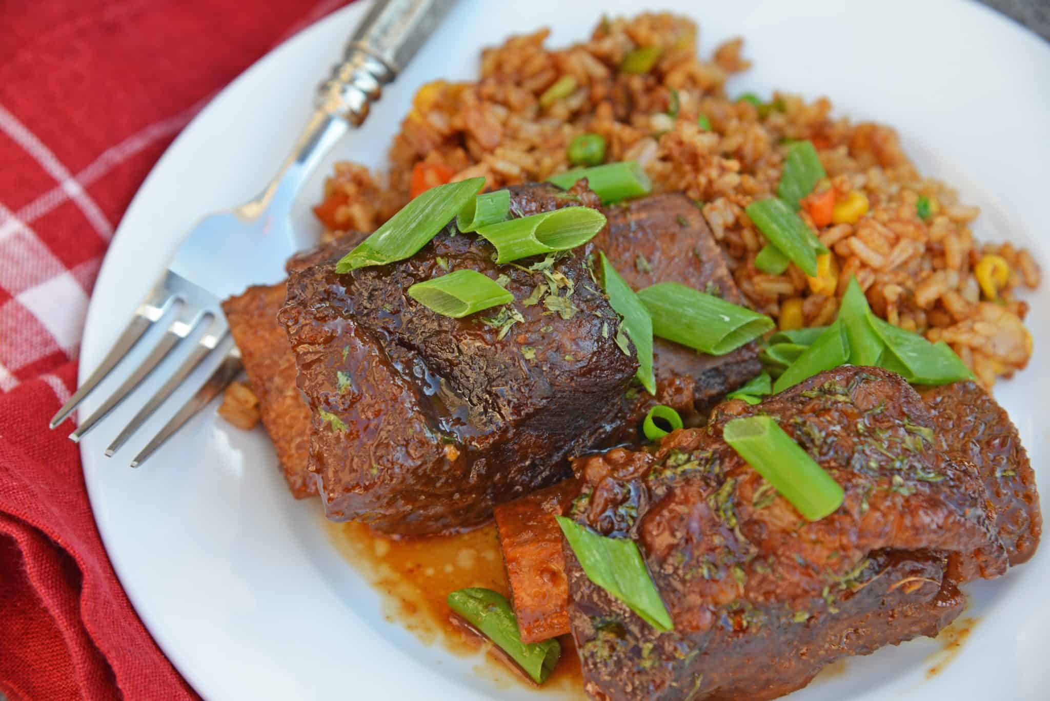Honey Ginger Short Ribs are a zesty and sweet, fall off the bone short rib recipe, braised to perfection and served with the best fried rice ever!