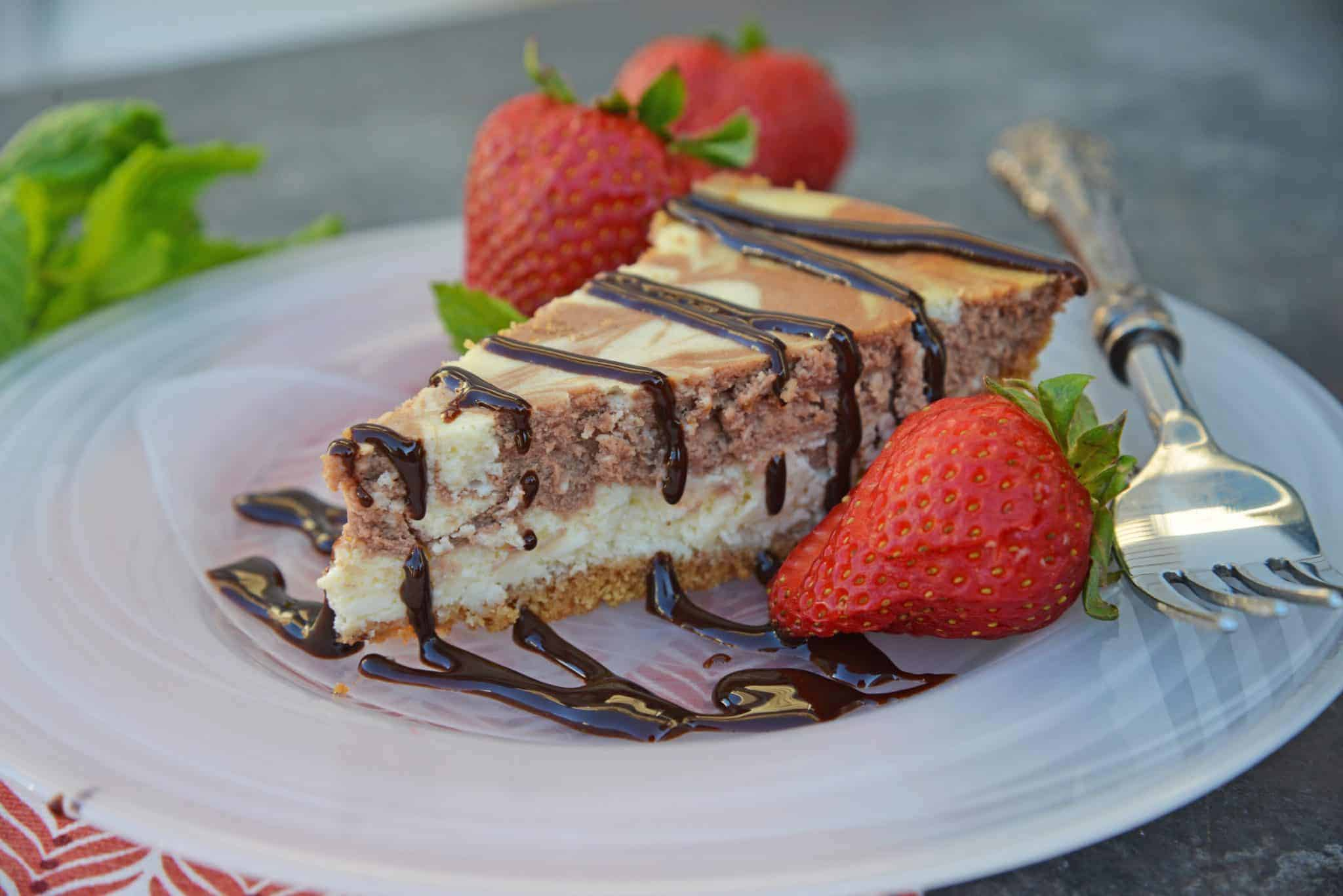 Marble New York Cheesecake is one of the best cheesecake recipes you'll ever come across! This dessert is a thicker but deliciously creamy cheesecake recipe! #newyorkstylecheesecake #bestcheesecakerecipes www.savoryexperiments.com