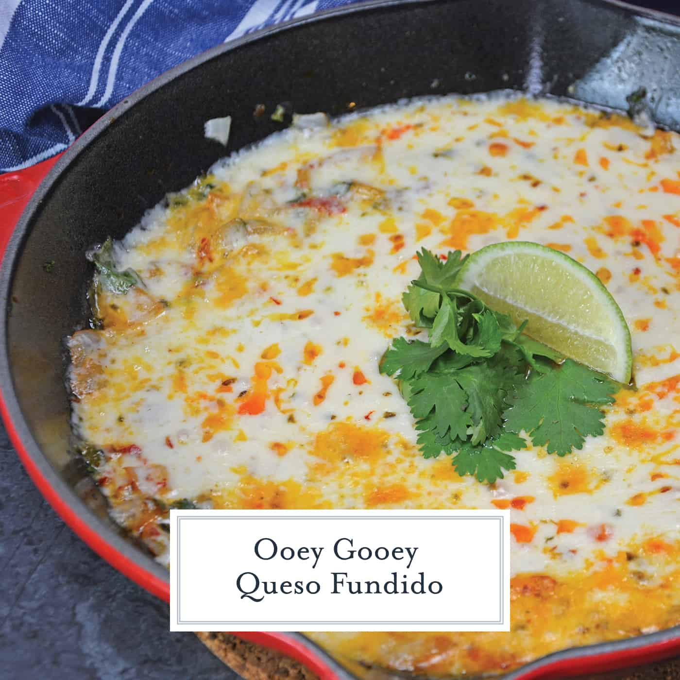 This Queso Fundido recipe is an easy Mexican cheese dip made of chopped vegetables, cilantro, chile powder and shredded cheddar and pepper jack cheese! #quesofundido #mexicancheesedip www.savoryexperiments.com