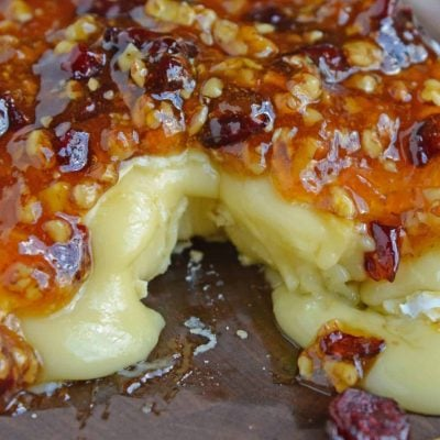 Apricot Cranberry Baked Brie is the ultimate appetizer. This baked brie appetizer will be perfect for any occasion. #bakedbrierecipe #bakedbrieappetizer www.savoryexperiments.com