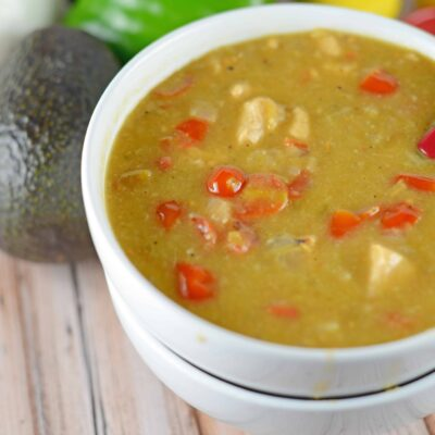 Chile Verde- green chile with tomatoes and spices served over a giant burrito, eggs, refried beans or in tacos. www.savoryexperiments.com