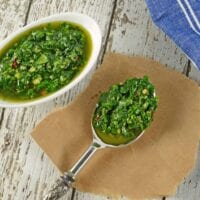 Authentic Chimichurri Sauce is easy to make and doubles as a marinade and sauce. Traditional chimichurri ingredients will flavor any dish!