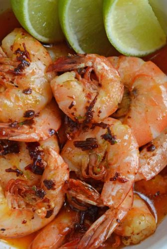 Chipotle Lime Buttered Shrimp is a delicious, spicy shrimp recipe! The chipotle peppers in adobo sauce with lime juice, make this recipe the perfect appetizer! #spicyshrimprecipe #sauteedshrimp www.savoryexperiments.com