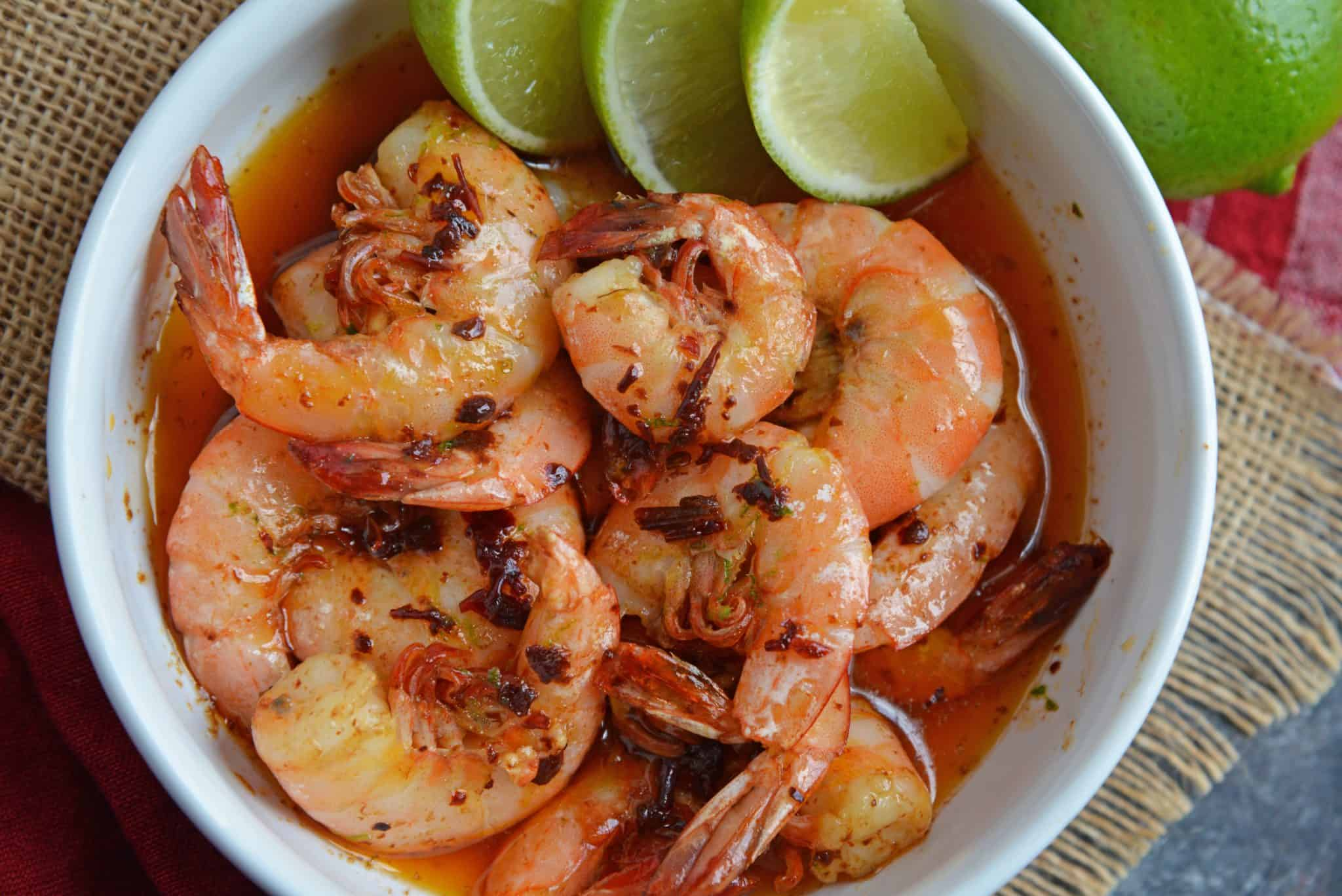 Chipotle Lime Buttered Shrimp is a delicious, spicy shrimp recipe! The chipotle peppers in adobe sauce with lime juice, make this recipe the perfect appetizer! #spicyshrimprecipe #sauteedshrimp www.savoryexperiments.com
