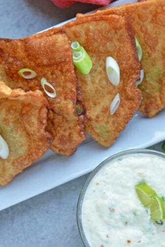 Avocado and Crab Rangoons are one of my favorite appetizer recipes! Creamy avocado, buttery crab and lush cream cheese with a Jalapeno Pineapple Sauce.