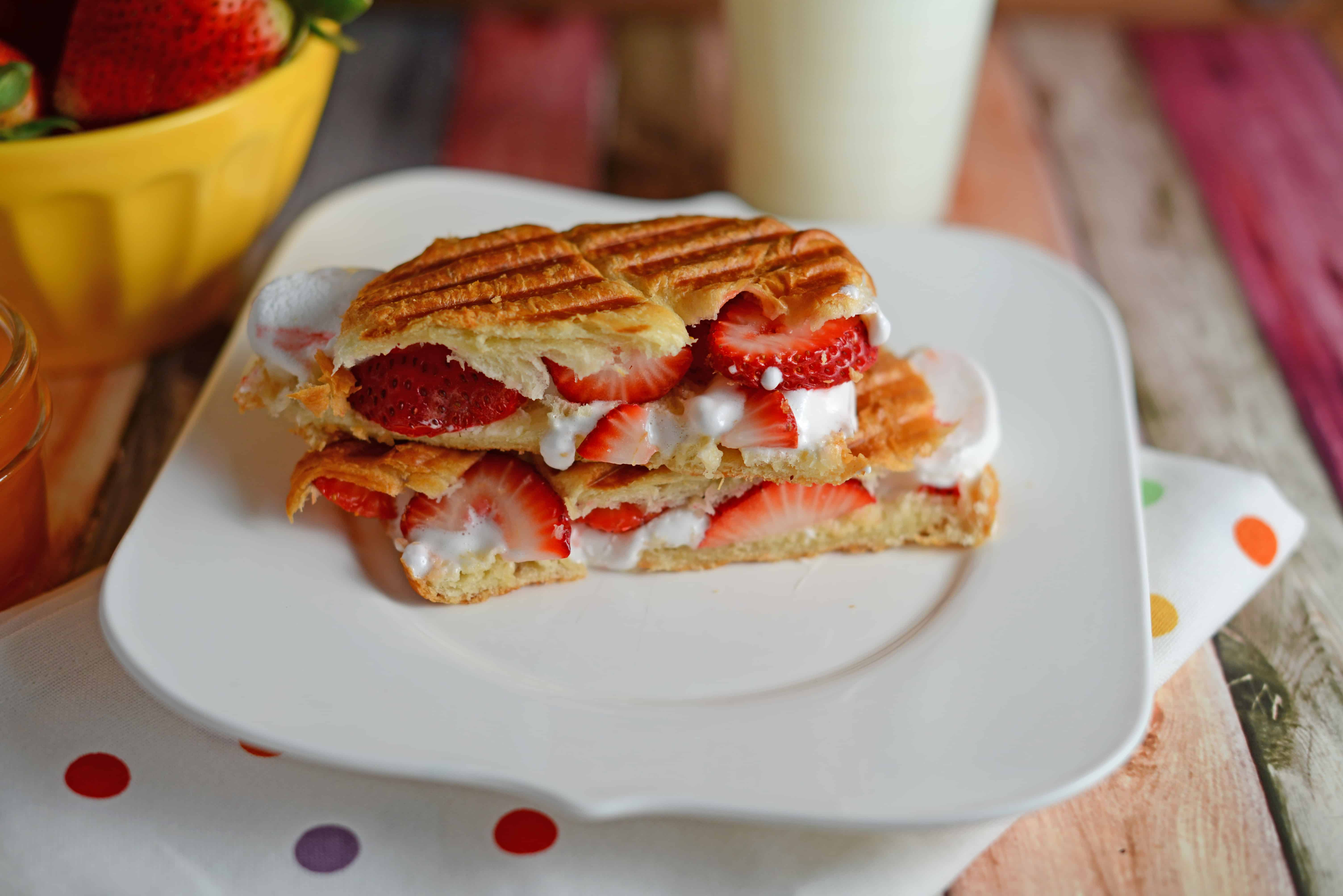 Dulce de Leche & Strawberry Croissant Panini- layers of decadent dulce de leche (or caramel), gooey marshmallow and freshly sliced berries all in a buttery croissant. This dessert only takes 10 minutes and is OH so good! www.savoryexperiments.com