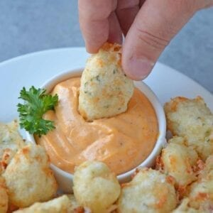 Fried Cheese Curds, also known as Beer Battered Cheese Curds, as the perfect fried cheese balls! Gooey little nuggets paired with a tangy dipping sauce. A great easy appetizer for snack idea!