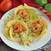 You will love this spicy Shrimp Tostadas recipe! The cooling sour cream and guacamole with the combination of the spicy shrimp is a mixture that you will love. #tostadarecipe #whatisatostada #shrimprecipes www.savoryexperiments.com