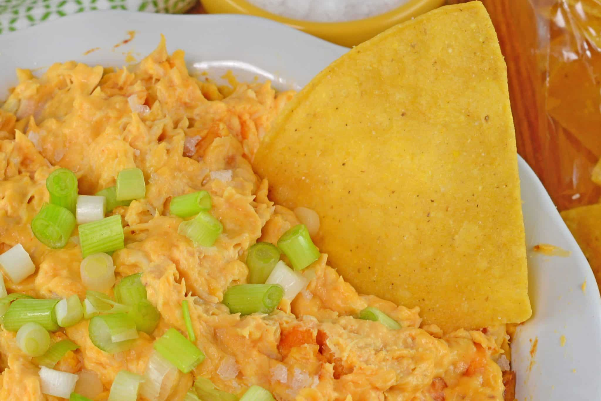 Buffalo Chicken Dip is a quick and easy appetizer for any party! Use pre-shredded chicken to save time for your spicy dip.
