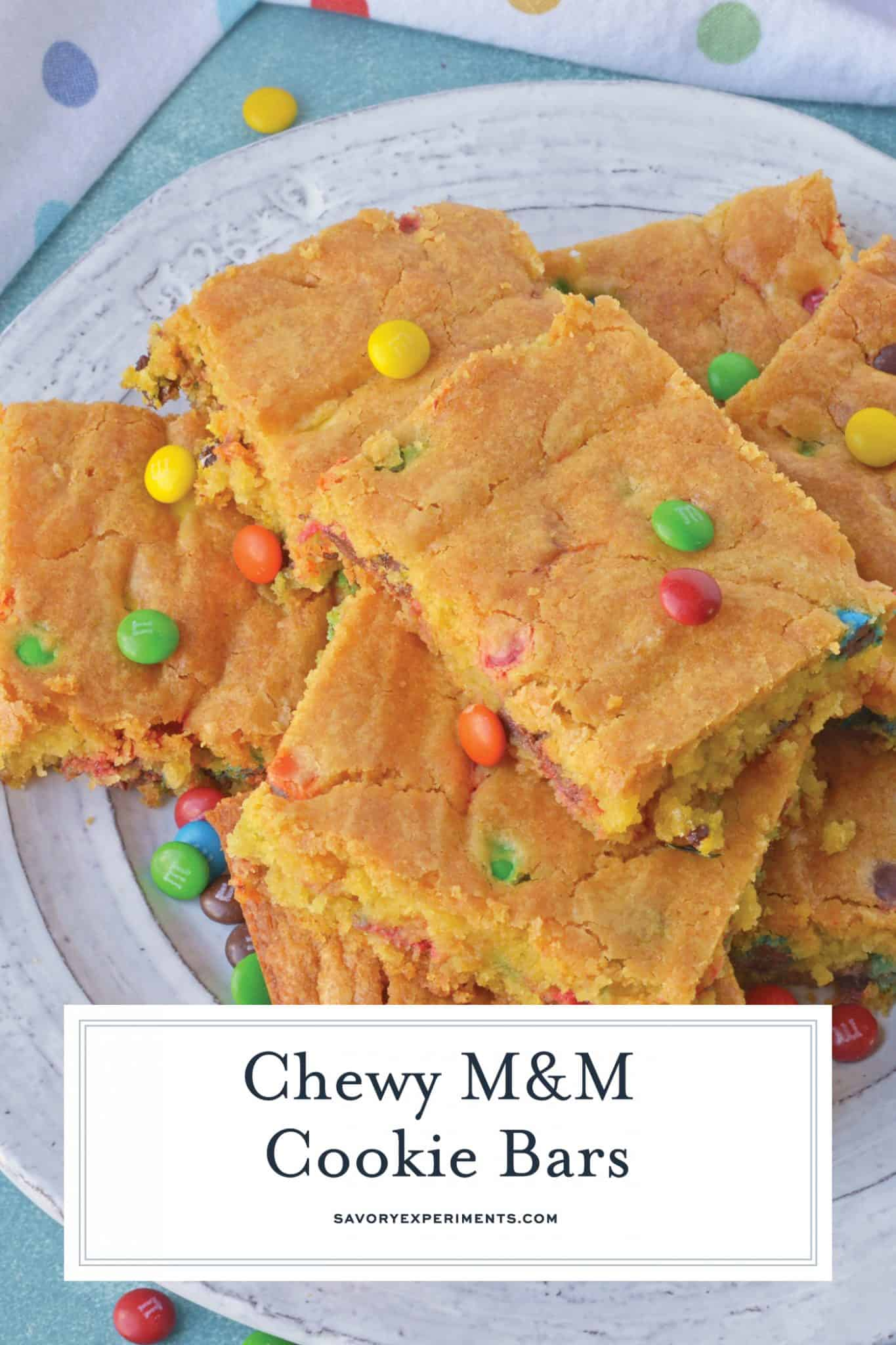Thick and chewy M&M Cookie Bars are perfect for your cookie exchange, dessert potluck or an after school snack using just a few ingredients! #cookiebars #easydessertrecipes www.savoryexperiments.com