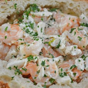 Creamy Shrimp Scampi Bread Bowl can be an easy appetizer or entree, dipping bread in the rich scampi sauce with succulent shrimp.
