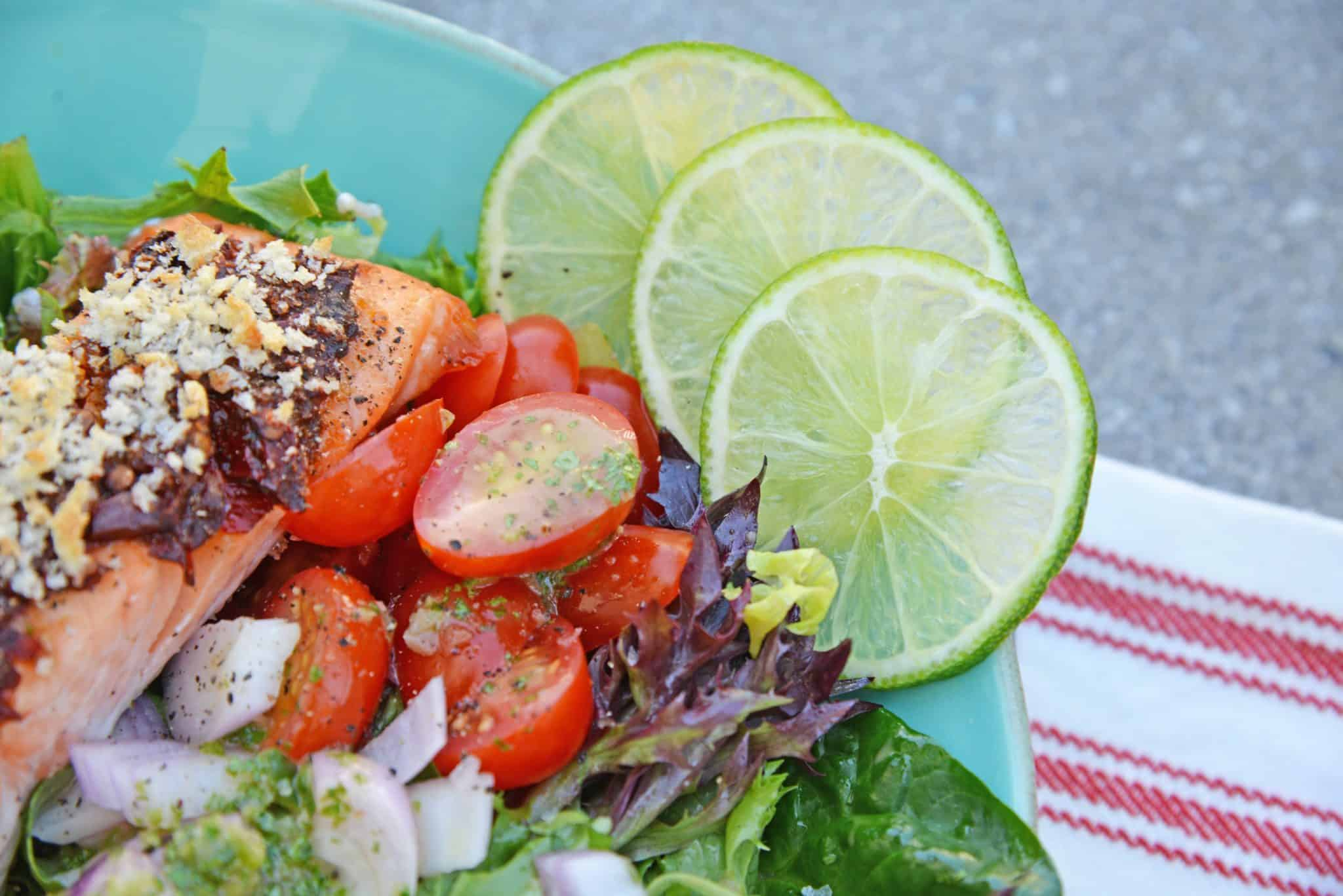 Crispy Chipotle Salmon Salad is a simple and healthy salad filled with a fun texture and spicy chipotle peppers. Top with Cilantro Lime Dressing. #salmonsaladrecipe #saladrecipes #bakedsalmonrecipe www.savoryexperiments.com