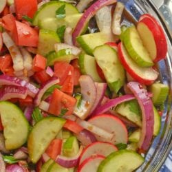 Fattoush Salad is of Arabic descent consisting of marinated vegetables, usually tomatoes and radishes, and tossed with grilled flatbread.#fattoushsalad www.savoryexperiments.com