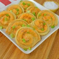 Buffalo Chicken Pinwheels are creamy, spicy buffalo dip rolled in buttery puff pastry and baked to a crispy perfection. The perfect appetizer for any event!