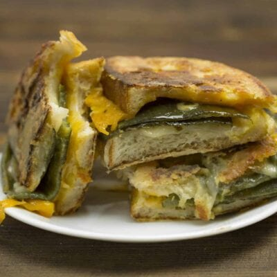 Chile Relleno Monte Cristo is a classic grilled cheese with pepper jack, cheddar and green chile and then battered and fried  Monte Cristo style. #montecristo #chilerelleno www.savoryexperiments.com