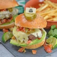 Taco Burgers are a spicy mix of tacos and burgers! Topped with pico de gallo, avocado slices, jalapenos, pepper jack cheese and cool sour cream.