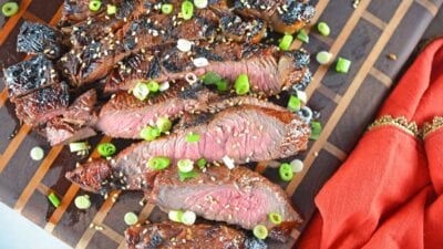 Asian BBQ Steak marinade can be used on any cut of beef, combining traditional Asian flavors like soy sauce, honey, ginger, sesame and garlic.#steakmarinade #bbqsteak #beefrecipe www.savoryexperiments.com