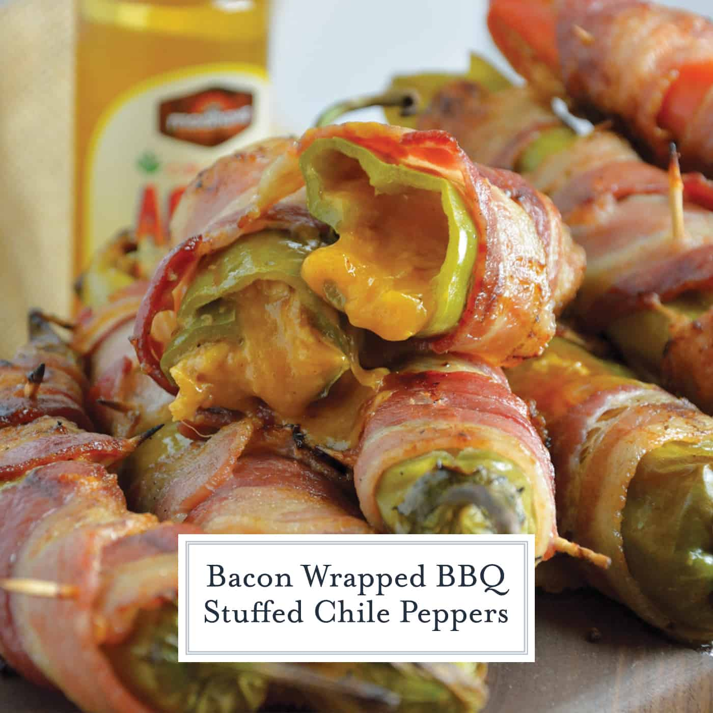 Bacon Wrapped BBQ Chicken Stuffed Chile Peppers are the ultimate BBQ Chicken recipe. Tender shredded chicken stuff in a chile pepper, wrapped in bacon and drizzled with sweet agave nectar. #BBQchicken #stuffedchilepeppers www.savoryexperiments.com