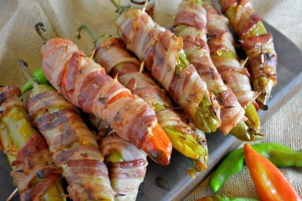 Bacon Wrapped BBQ Chicken Stuffed Chile Peppers Recipe- shredded chicken tossed in your choice of BBQ sauce and sharp cheddar cheese, stuffed into a large chile, wrapped in bacon and slow grilled. As seen on Fox News!
