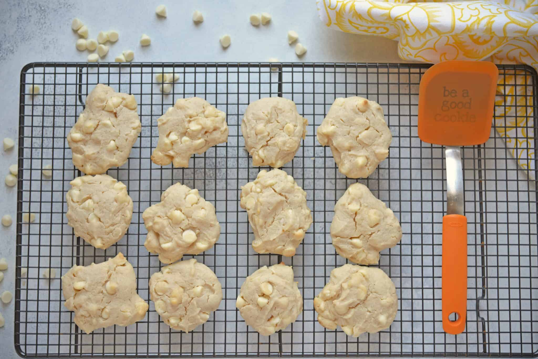 These Lemon White Chocolate Chip Cookies are a cross between a chocolate chip cookie & a lemon sugar cookie! A perfectly fluffy & mouth watering combination! #lemoncookierecipe #lemoncookies #whitechocolatechipcookies www.savoryexperiments.com