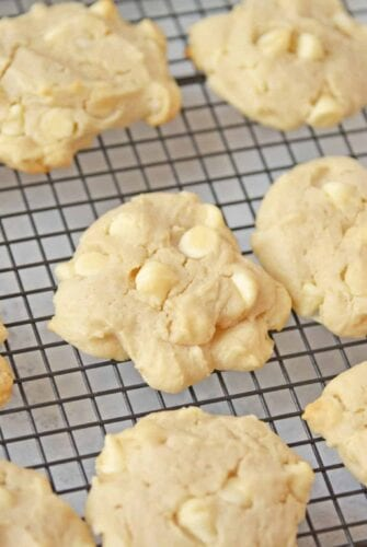 lemon white chocolate chip cookies on a wire rack