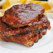 This is the Best BBQ Ribs Recipe you'll ever find! This pork ribs recipe falls right off the bone and is smothered in an award winning BBQ sauce! #howtomakeribsonthegrill #BBQribs www.savoryexperiments.com