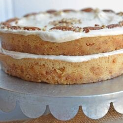 Brown Butter Caramel Cake is a two layer naked cake made with toffee bits and salted caramel frosting.