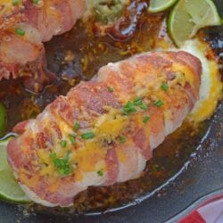 Jalapeno Bacon Wrapped Chicken is a cheese stuffed chicken breast recipe using three cheeses and fresh jalapenos. Avocado and lime cool off the hot flavors. #baconwrappedchicken #jalapenopopperchicken www.savoryexperiments.com