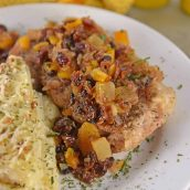 Fruit Smothered Pork Chops are pan fried pork chops with a zesty dried fruit sauce, taking 30 minutes from start to finish! #fruitsmotheredporkchops #panfriedporkchops www.savoryexperiments.com