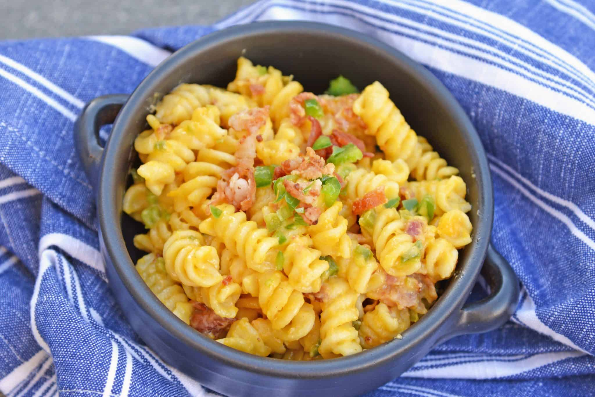 Delicious Three Cheese Jalapeno Bacon Mac and Cheese is the BEST mac and cheese recipe made in the slow cooker with gouda, cheddar bacon and jalapenos!