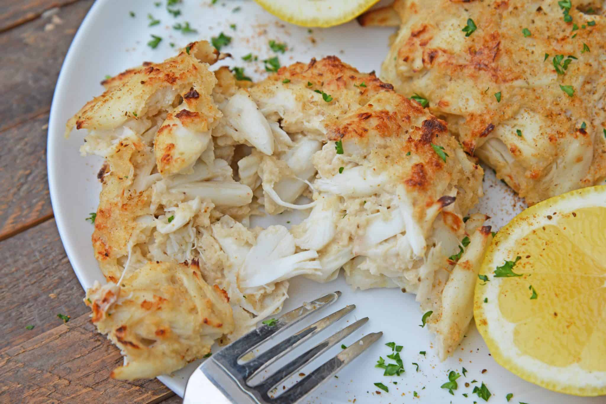 Maryland Crab Cakes are made with jumbo lump crab meat with little filler, Dijon mustard and Old Bay Seasoning plus secrets to making authentic Chesapeake crab cakes! #marylandcrabcakes #crabcakerecipe www.savoryexperiments.com