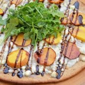 Peach Pizza is a delicious pizza variation that uses fresh peaches, melty mozzarella and gorgonzola cheeses and a sweet balsamic reduction sauce. The best homemade pizza recipe! #homemadepizzarecipe www.savoryexperiments.com